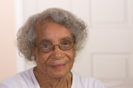aging american: Portrait of African American woman wearing glasses