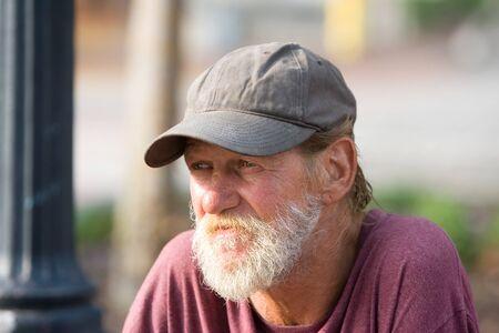 Portrait of a senior citizen man gazing.