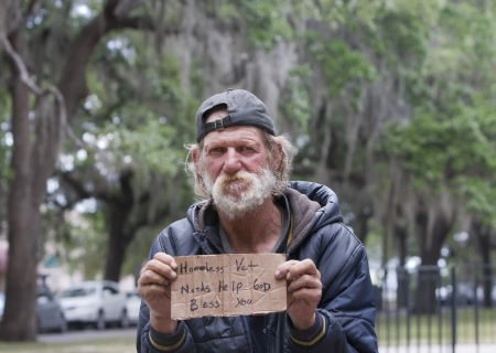 homeless person: Homeless man holding sign