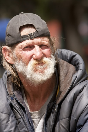 Portrait of homeless man outdoors Imagens