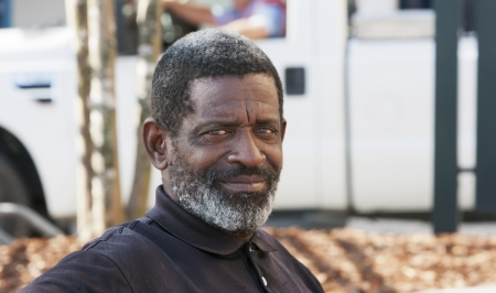 African-American man sittin and relaxing outdoors during the daytime