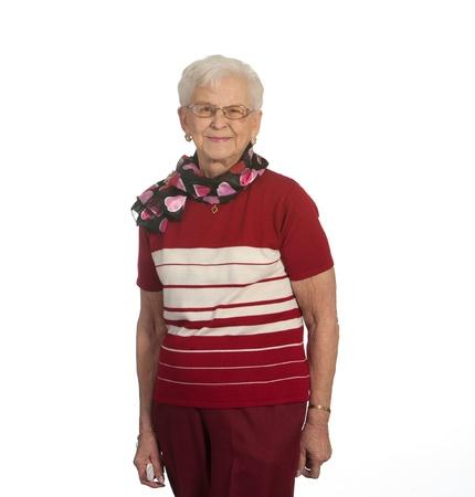 Portrait of elderly lady  Isolated against white background  Foto de archivo