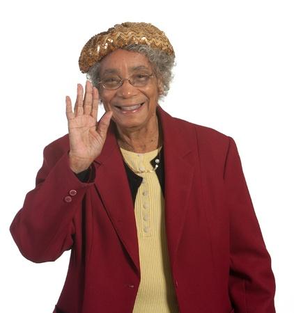 Happy elderly african american woman waving photo