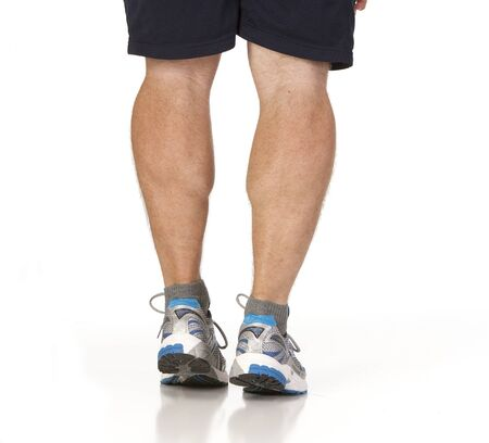 Runner stretching calf muscles of legs. Isolated against white background.