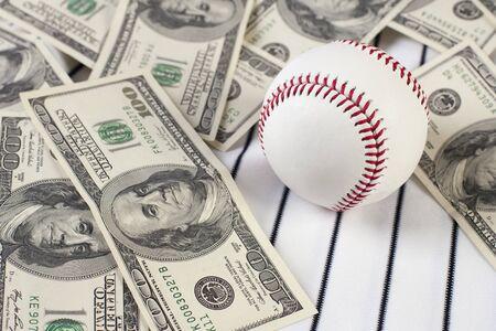 Business of baseball and money. Focus is on baseball.