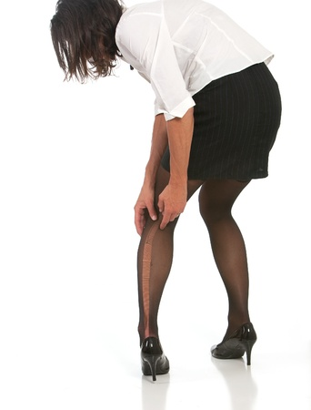 business woman with run in stocking. Isolated against white background.