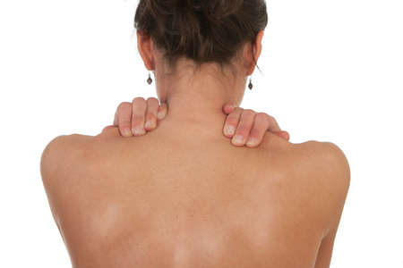 Woman with neck and shoulder muscle pain. Shot against white background. photo