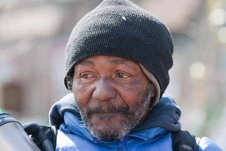 hobo: Closeup of homeless african american man. Outside during the daytime. Stock Photo