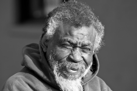 hobo: Portrait of old African American homeless man in black in white outdoors  Stock Photo