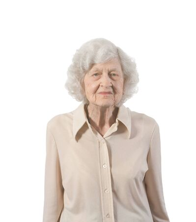 Portrait of elderly lady standing  Shot against white background  photo