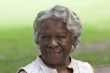 Portrait of smiling african american woman outdoors