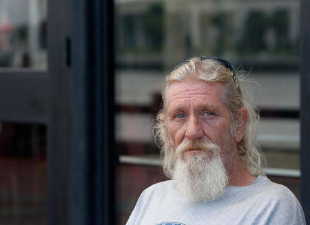Homeless man with beard outdoors  Image has copyspace available  Stock Photo