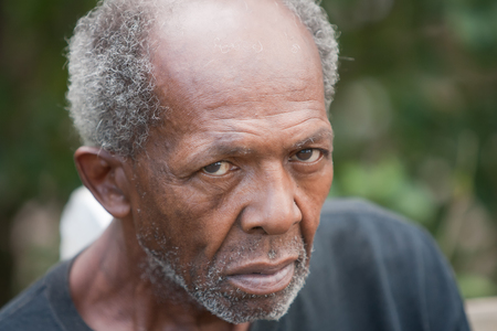 Homeless elderly african american man outside during the day Stock Photo