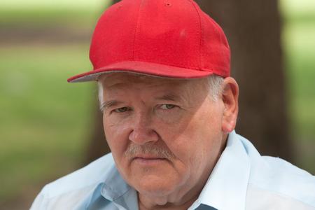 Elderly man wearing hat outside during daytime