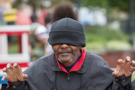 Happy and playful african american homeless man having fun