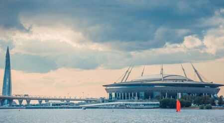 ST.PETERSBURG, RUSSIA - JULY 23, 2019 - Gazprom Arena stadium and Lakhta Center skyscraper shot from Neva river.
