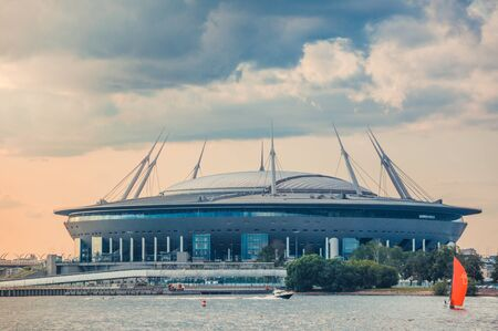 ST.PETERSBURG, RUSSIA - JULY 23, 2019 - Gazprom Arena stadium shot from Neva river at sunset. 新聞圖片