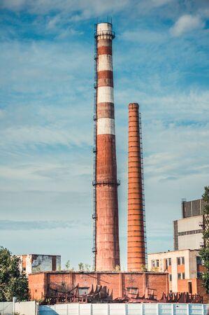Industrial chimneys without smoke on sunny day. Urban landscape. 版權商用圖片