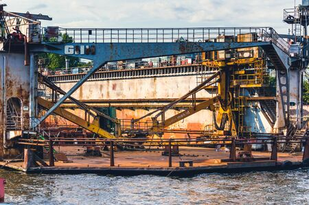St.Petersburg, Russia - July 23, 2019 - Heavy machinery on floating barge on Neva river