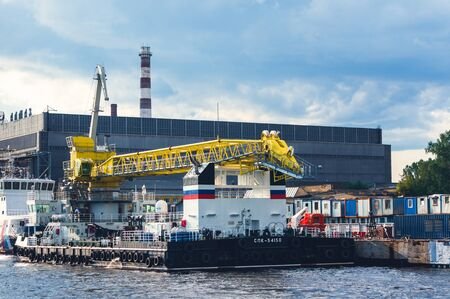 St.Petersburg, Russia - July 23, 2019 - Floating crane near shipyard Almaz on Neva river