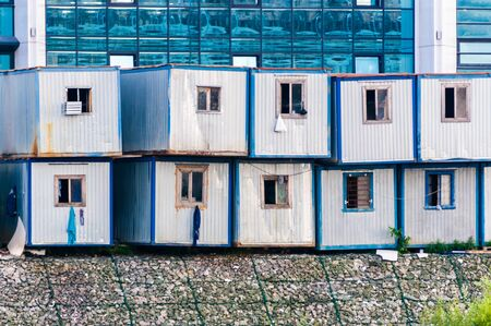 Workmen's temporary houses in rows near new building in Russia