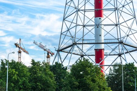 Close view of St.Petersburg TV tower surrounded by trees with construction cranes nearby 版權商用圖片