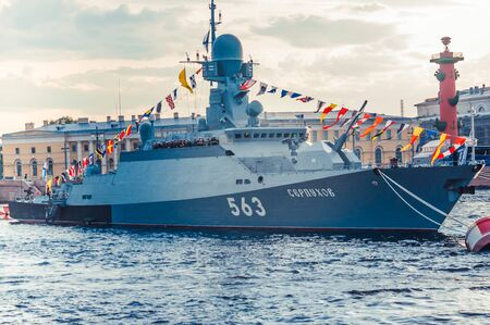 ST.PETERSBURG, RUSSIA - JULY 23, 2019 - Russian warship with decorations at celebration of the Navy Day on Neva river