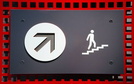 Concept of rectangular sign with arrow pointing up and figure of person going upstairs