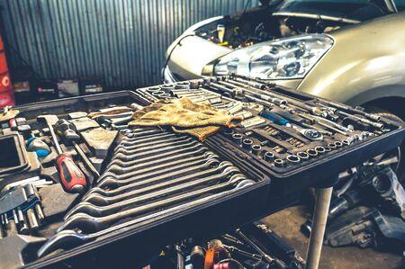 Fixing mechanical hand tools in open box at car repair shop indoors