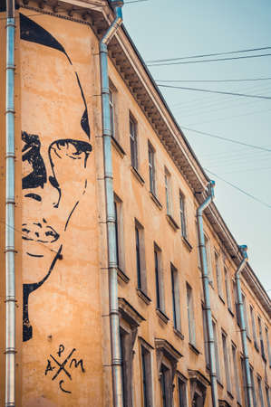 ST.PETERSBURG, RUSSIA - SEPTEMBER 10, 2019 - Graffitti with portrait of Daniil Kharms in St.Petersburg, Russia