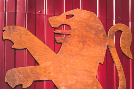 ST.PETERSBURG, RUSSIA - AUGUST 20, 2019 - Big wooden Peugeot logo on metal wall