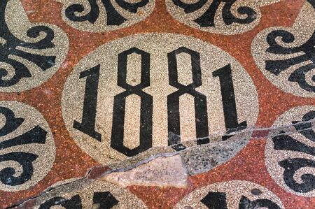Inscription 1881 on shabby cracked floor in an old building in St. Petersbug, Russia