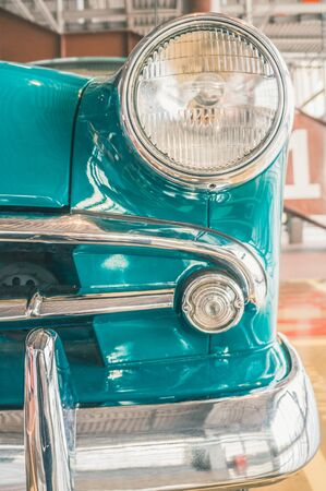 Details of retro vintage car with round headlamp