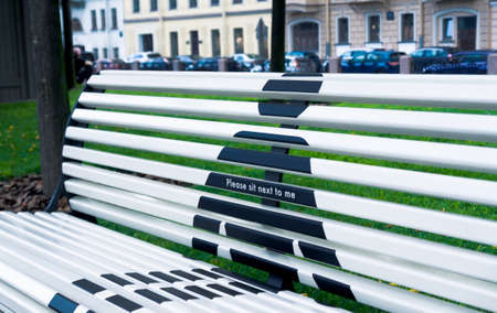 Concept of social distance of bench in public park