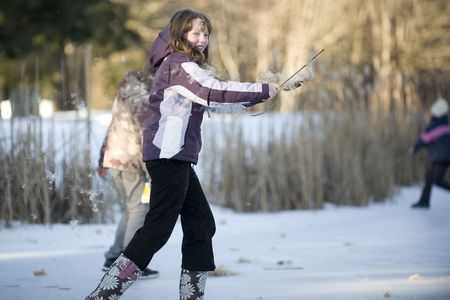 bullrush: A girl rubs the fluff off a bullrush and it flys through the air.