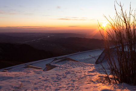 landscape view from mount grapp top with war ossuary at sunrise in winter with snow