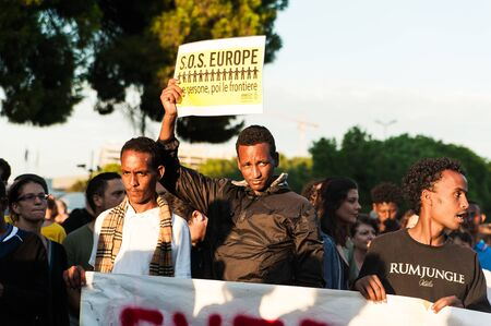 Rome, Italy - 20 june 2018: african migrants and refugees march asking for hospitality and residence permit Stock fotó - 133910990