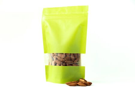 almond filled plain green paper doypack stand up eco friendly bag with window zipper on white background