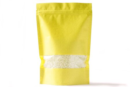 yellow paper blank doy pack bio pouch with window zipper on white background filled with rice