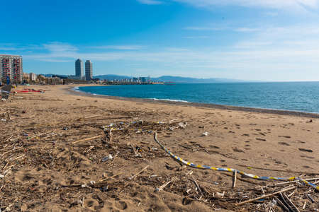 Barcelona, spain - 2 may 2020: view of touristic beach empty with no people, due to the lock down imposed against coronavirus, which has caused a major crisis in the tourism and travel sectors Editorial