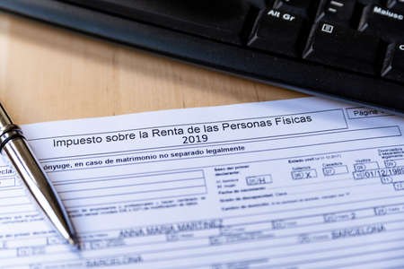 Barcelona, Spain - 20 april 2020: close up of declaracion de la renta form for spanish tax declaration a symbol of coronavirus and spanish economy and freelancers Editorial