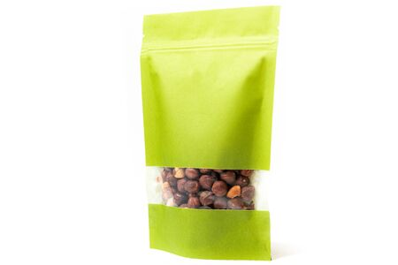 green paper doypack standup pouch filled with hazelnuts with window and zipper front view on white background