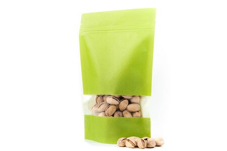 filled green paper biodegradable doy pack flexible packaging with window and zipper on white background