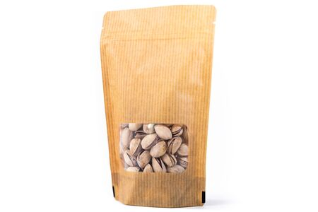 stripped paper doypack pouch filled with dry fruit, flexible packaging with window zipper on white background Foto de archivo