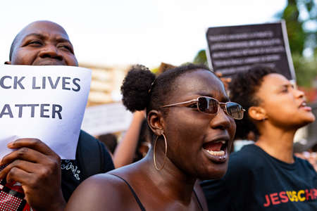 Barcelona, spain - 1 june 2020: Black lives matter woman march demanding end of police brutality and racism against african-americans chanting and screaming