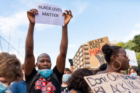 Barcelona, spain - 1 june 2020: Black lives matter movement march in demanding end of police brutality and racism against african-americans and people of color after the killing of George Floyd, chanting and holding banners Editorial