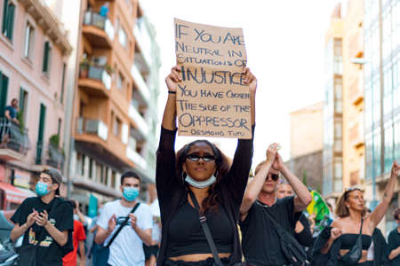 Barcelona, spain - 1 june 2020: black confident and determined woman march in demanding end of police brutality and racism with black lives matter movement for end of injustice Editorial