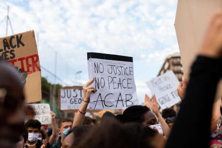 Barcelona, spain - 1 june 2020: Black lives matter movement march in demanding end of police brutality and racism against african-americans and people of color after the killing of George Floyd, chanting and holding banners Foto de archivo - 149227131
