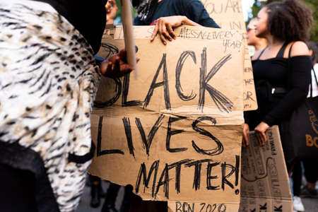 Barcelona, spain - 1 june 2020: close up of Black lives matter banner during demonstration against police brutality and racism against african-americans after the killing of George Floyd Foto de archivo - 149227138