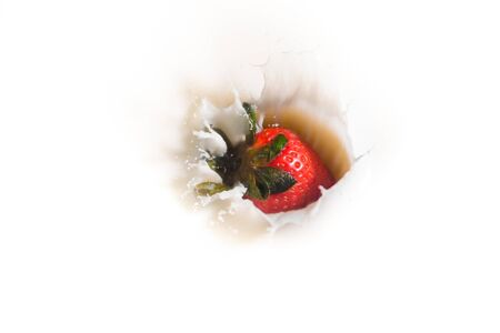 close up of red ripe strawberry falling on white milk and yogurt with a splash, symbol of summer fruit and healthy organic diet Foto de archivo - 149678200